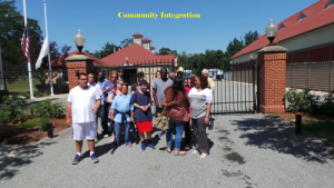 Group of People Standing in front of a Gate