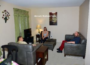 Three People Sitting in an Apartment